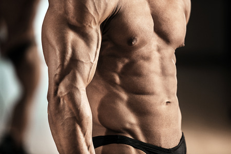 Close-up of muscular man with strong biceps photo
