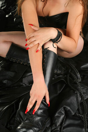 Attractive woman and black leather photo