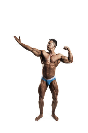only one mid adult male: Male bodybuilder posing on white background