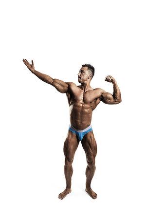 male bodybuilder: Male bodybuilder posing on white background