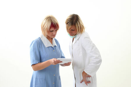 Doctor and nurse discusing what to do