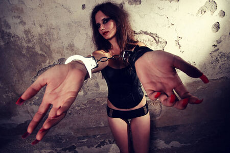 Sexy lady with long red nails wearing handcuffs photo