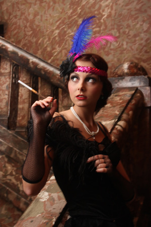 Glamorous girl on a staircase photo