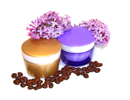 feminine beauty: jar natural cream sprig bloom purple white lilac roasted coffee beans cosmetic concept scrub set isolated on white background. Feminine, beauty