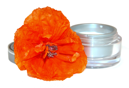 feminine beauty: red poppy jar with cream isolated on white background. Feminine, beauty and cosmetics concept,