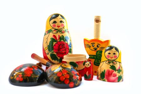 matryoshkas: set of russian national artistic wooden whistle cat, painted spoon, souvenir matryoshka doll