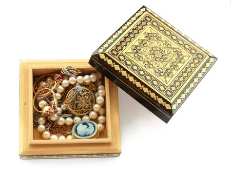 cameo: carved wooden box,  gold jewelry, ring with cubic zirconia, pendant, brooch, cameo, watches, pearl strand isolated Stock Photo