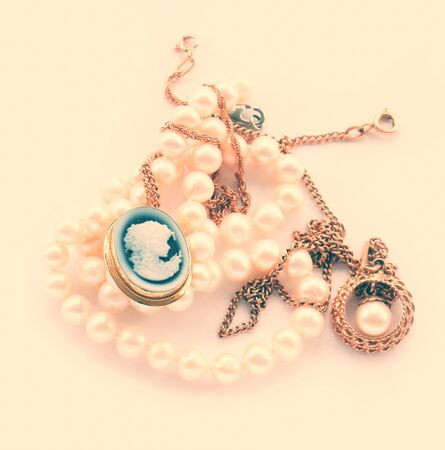 cameo: Vintage  gold jewelry pendant, brooch, cameo, pearl strand isolated