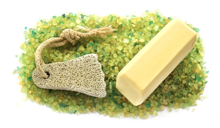 revitalizing: stripe background of large salt crystals colorful yellow green bath with juniper spa pumice in the form of a foot with a rope, soap bar