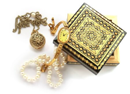 cameo: carved wooden box,  gold jewelry, pendant, brooch, cameo, watches, pearl strand isolated