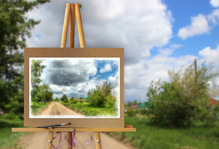 photo manipulation: Easel with a painting on a canvas on a landscape. Distant horizon attracts attention and the road calls for adventure. Photo manipulation concept.