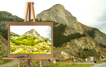 the settlement: Easel with a painting watercolor illustration of Altai Mountains on a canvas on a landscape.  Lost settlement, road. Photo manipulation concept. Stock Photo