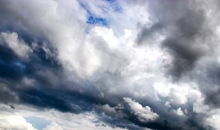 gleams: Oil paint background of the dark  steel clouds and  blue sky gleams before the storm