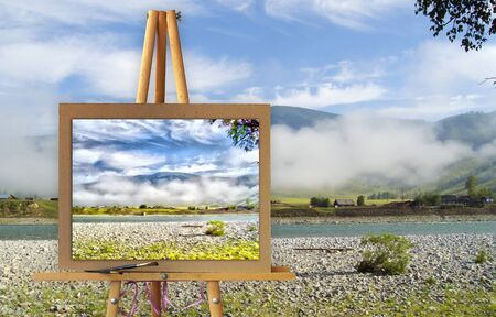 photo manipulation: Easel with a painting watercolor illustration of Altai Mountains on a canvas on a landscape. Lost settlement, river road, misty high peaks of Altai Mountains fresh air undisturbed pristine nature. Photo manipulation concept.