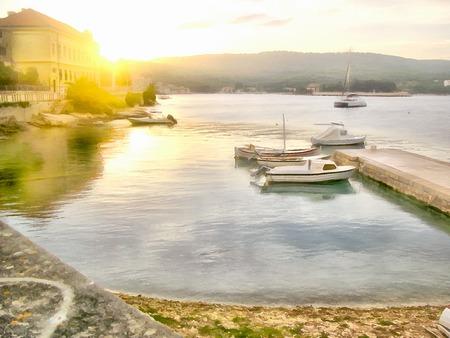 panoramic view: Panoramic view of beautiful bay, small town, illustration watercolor, sailboat in the Mediterranean Sea, coast of Croatia at sunset