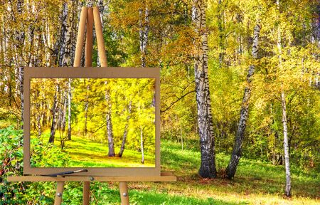 Easel with a painting watercolor illustration of Tall slender white birch trunks in a golden dress  Russian autumn landscape. Photo manipulation concept. Stock Photo