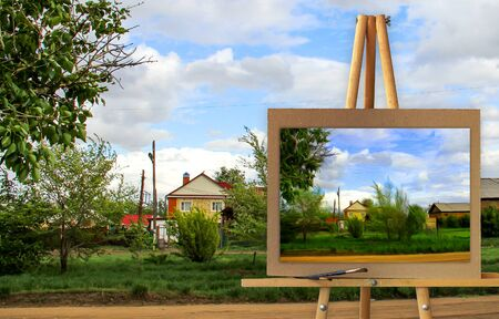Easel with a painting watercolor rural landscape with village garden  Photo manipulation concept.