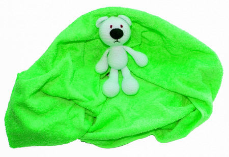 Colorful towel and toy crocheted polar bear isolated on a white background Stock Photo