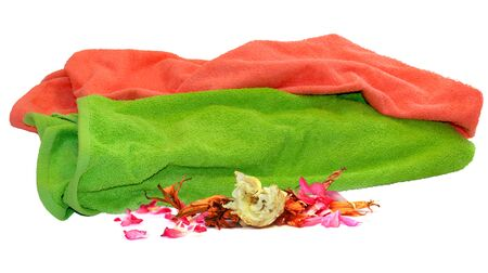 Used colorful towel isolated  lie a bunch and petals of fading flowers dry delicate leaves of  iris, rose,  pelargonium, on white background Stock Photo