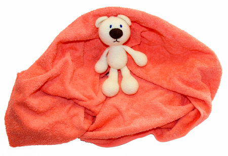 colorful towel and Toy crocheted polar bear isolated on a white background