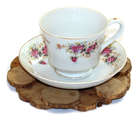 juniper stand under a hot, porcelain couple cup and saucer isolated Stok Fotoğraf