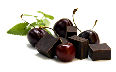 black chocolate lump and dark large cherry isolated on white Stok Fotoğraf