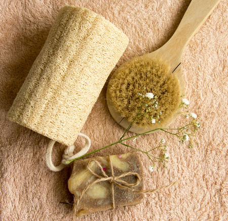 cosmetic concept with towel, brush, soap scrub, coffee beans, flower 版權商用圖片