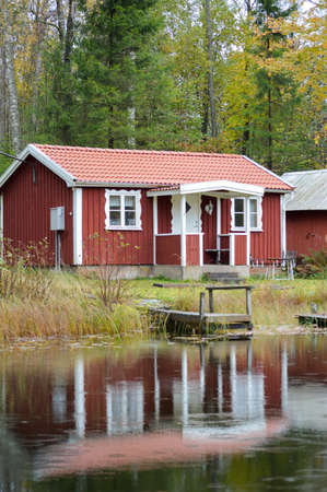 Red Cabin in Sweden Stock Photo