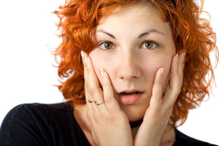 ajar: Surprised young women with red hair and ajar mouth Stock Photo