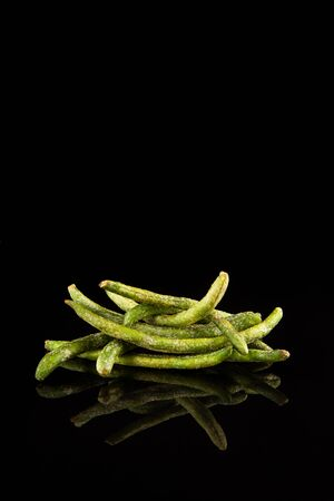 Healthy vegetable snack of green string beans. Natural chips. Crispy, dried vegetables with the addition of molasses.