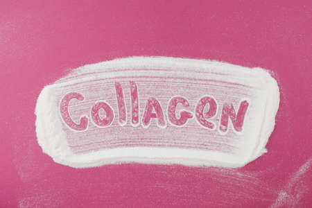 Inscription Collagen of Collagen powder pink background. Extra protein intake. Natural beauty and health supplement for skin, bones, joints and gut.