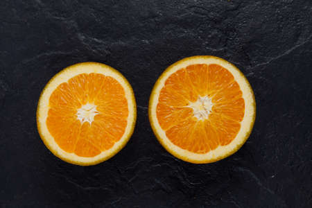 Navel Chocolate oranges - new variety of oranges. Uniquely colored fruits can be found in European markets during winter months. Cultivated in Spain.