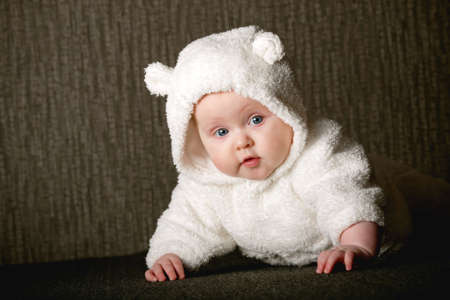 little baby in white bear costume photo