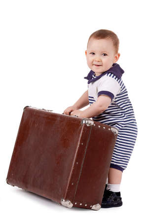 little funny boy with suitcase Stock Photo
