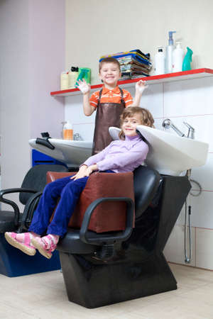 children play in the barbershop photo