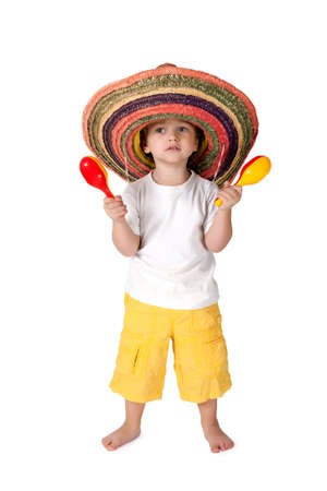 little boy in sombrero with with maracas
