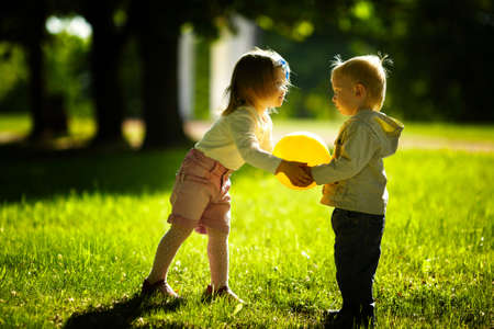 child ball: boy and girl playing with ball