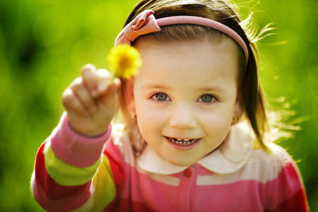 little funny girl with dandelion photo