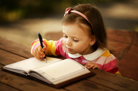hand writing: a little girl learning to write