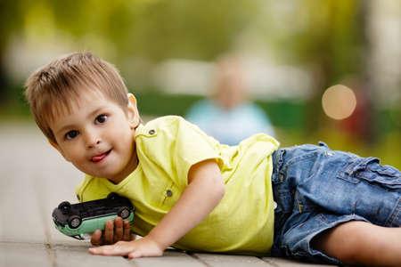 play boy: little boy plays with toy car
