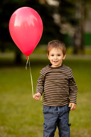 little funny boy with balloon photo