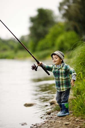 a little boy fishing