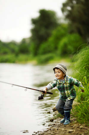 fishing bait: a little boy fishing