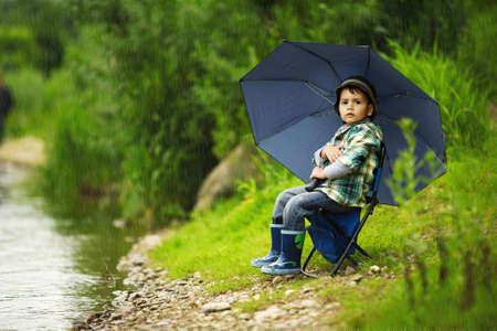little boy with umbrella photo
