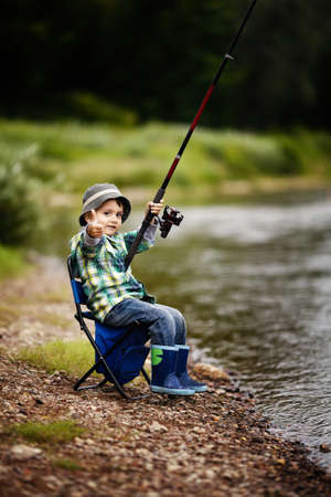 fishing lure: a little boy fishing