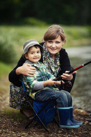 a little boy and mother fishing photo