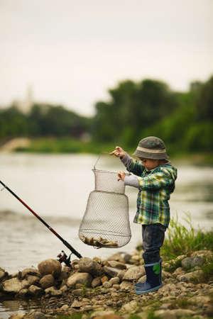 a little boy fishing photo