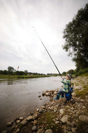 a little boy fishing Stock Photo - 16907544