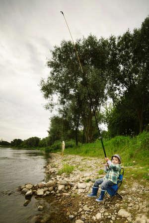 a little boy fishing Stock Photo - 16907538
