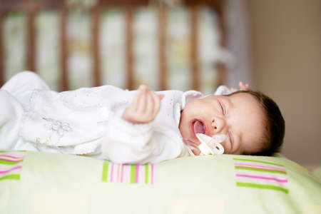 Beautiful newborn baby lying in his bed Stock Photo - 17495364